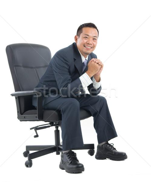 Asiático homem de negócios cadeira Foto stock © yongtick