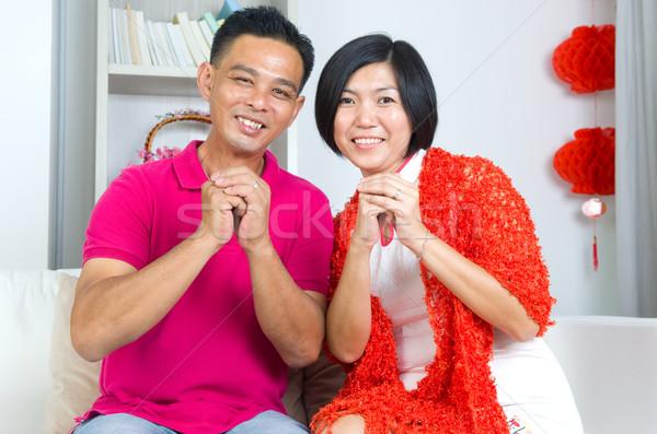 Asiático casal chinês gesto saudação cara Foto stock © yongtick