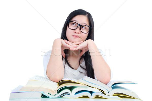 Asiático estudante menina jovem pensando livro Foto stock © yongtick
