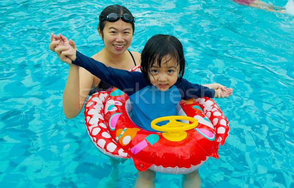 アジア 家族 泳ぐ 管 演奏 スイミングプール ストックフォト © yongtick