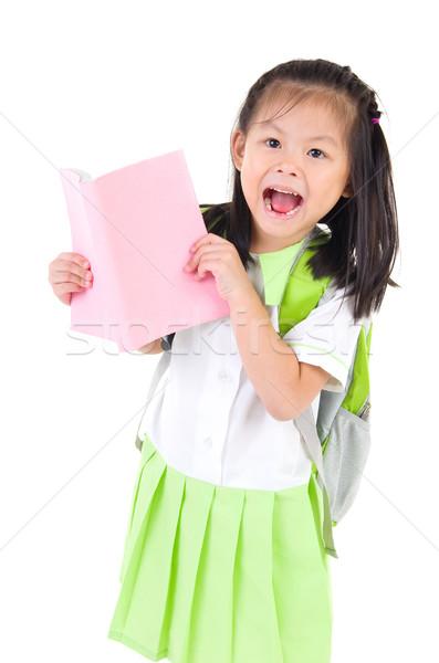 Asiático feliz pequeno aluna livros Foto stock © yongtick