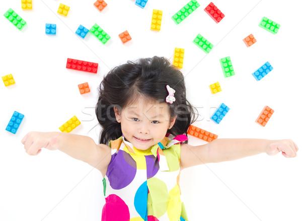 Asiático menina piso jogar colorido Foto stock © yongtick