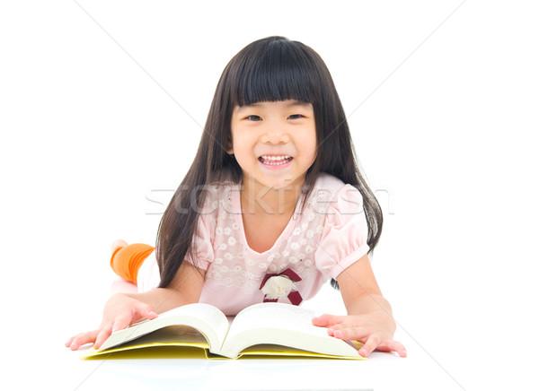 Bambino istruzione asian ragazza piano lettura Foto d'archivio © yongtick
