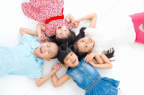 Asian familie meisje kinderen jongen vloer Stockfoto © yongtick
