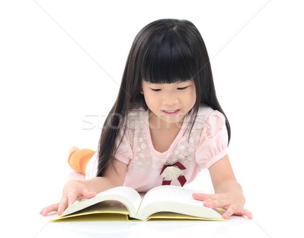 Asian meisje lezing vloer kind onderwijs Stockfoto © yongtick