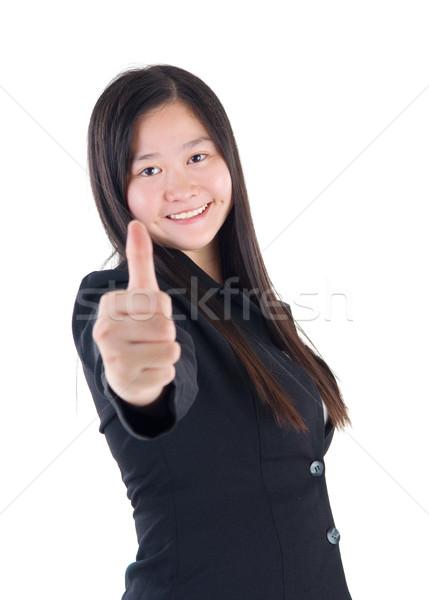 Asian meisje duim omhoog teken witte Stockfoto © yongtick