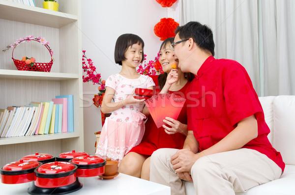 Ano novo chinês asiático família celebrar mulher feliz Foto stock © yongtick