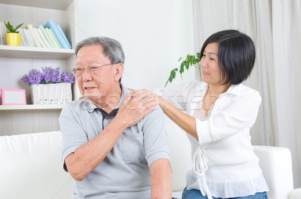 Asya aile yaşlı adam omuz ağrısı oturma kanepe Stok fotoğraf © yongtick