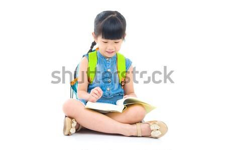 Asiático menina livros sessão piso Foto stock © yongtick