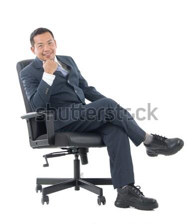 Asian uomo d'affari sedia braccia incrociate Foto d'archivio © yongtick