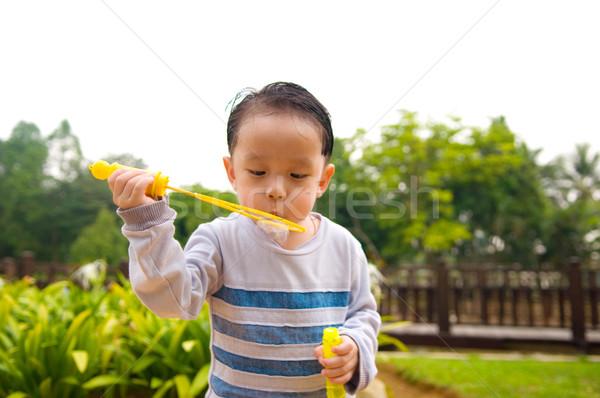 Asiático criança menino ao ar livre criança Foto stock © yongtick