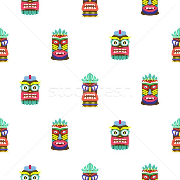 Colorful tiki mask seamless pattern vector. Stock photo © yopixart
