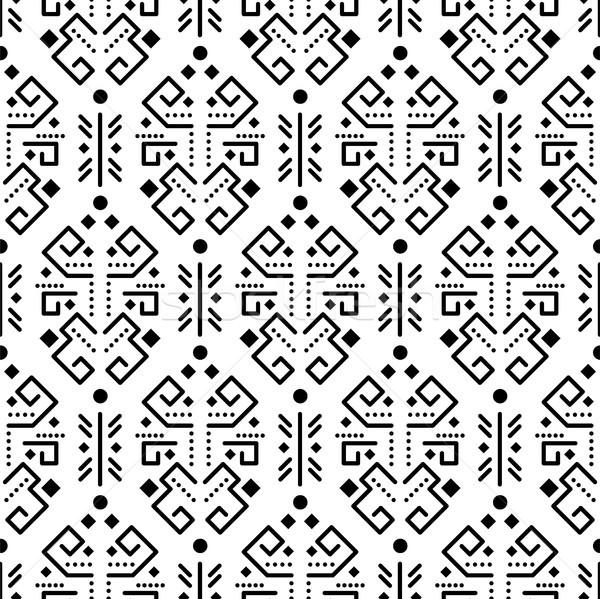 Tribal ornament seamless vector pattern. Stock photo © yopixart