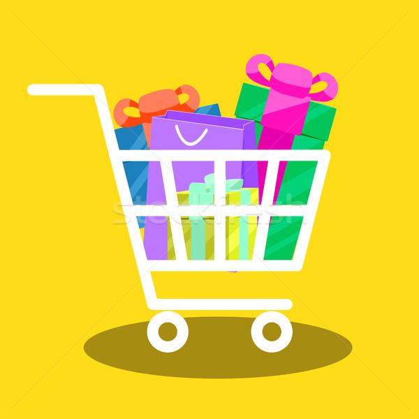 Shopping cart full of gift boxes vector. Stock photo © yopixart