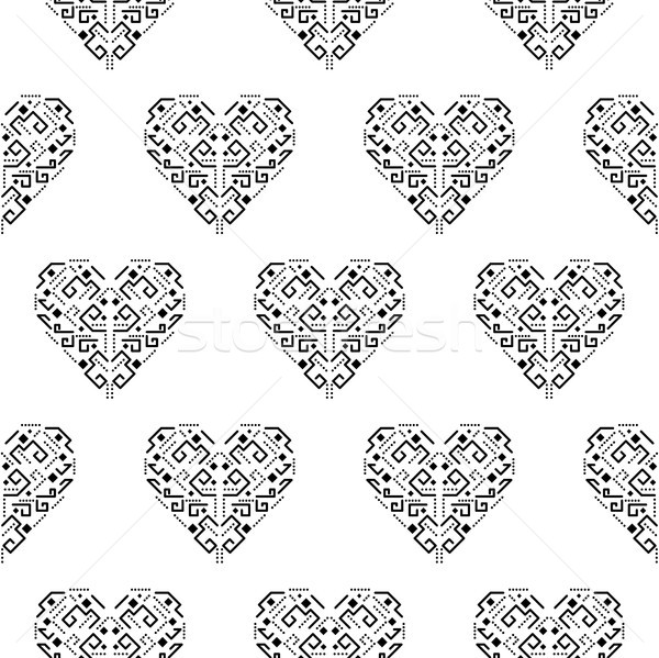 Tribal heart shape ornament seamless vector pattern. Stock photo © yopixart