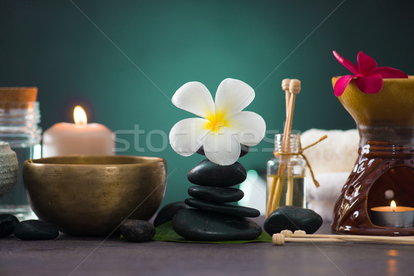 Balanced spa stones with green leaves background. Stock photo © yuliang11
