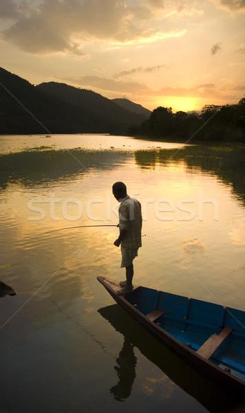 Stockfoto: Vissen · silhouet · man · water · zonsondergang · natuur