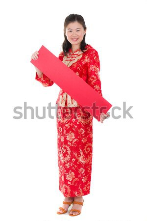 chinese new year girl greeting with ang pow sign for prosperity Stock photo © yuliang11