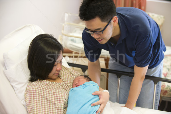 Asian chinese newborn baby girl and daddy in hospital Stock photo © yuliang11