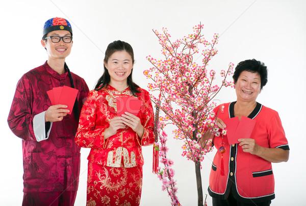 chinese new year family  with ang pow Stock photo © yuliang11