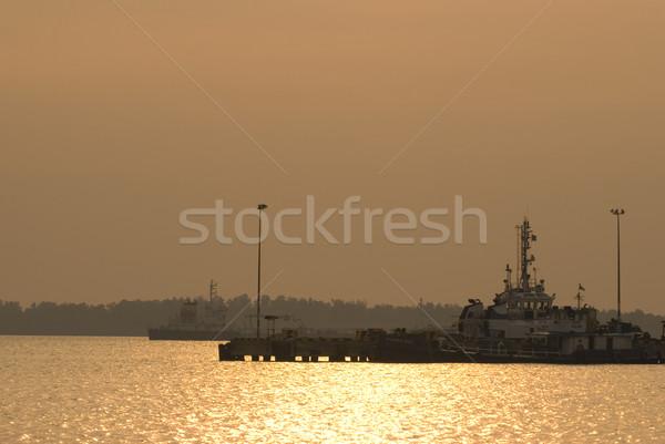ship yard during sunset Stock photo © yuliang11