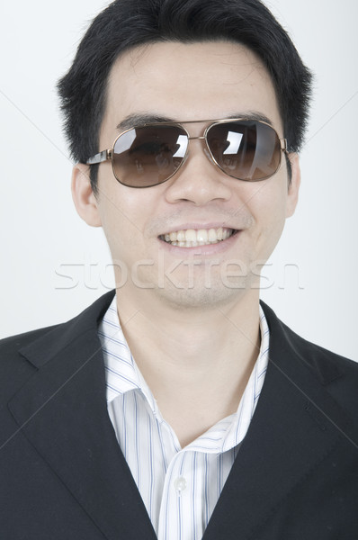Gülümseme portre genç Asya iş adamı gülen Stok fotoğraf © yuliang11