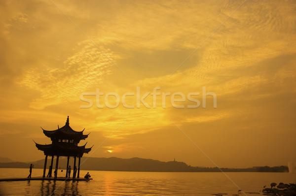 Chinese pagode mijlpaal zonsondergang landschap brug Stockfoto © yuliang11
