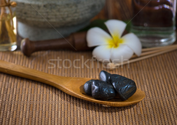 hot stone massage with spa treatment items on the background Stock photo © yuliang11