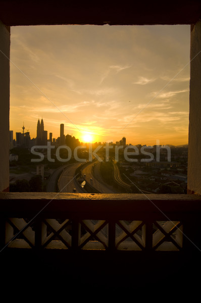 beautiful sunset view in kuala lumpur city from a window Stock photo © yuliang11