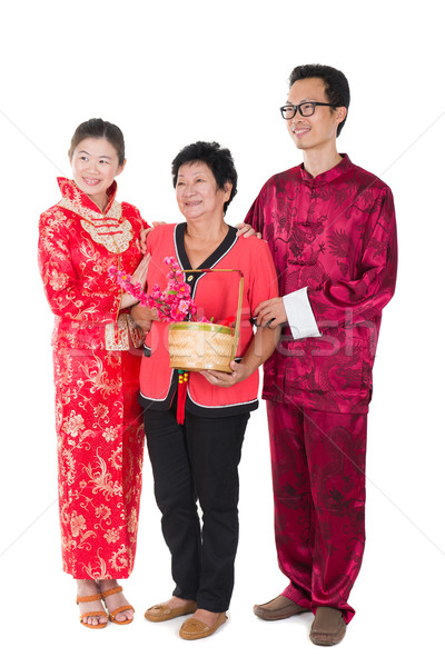 chinese new year family with ang pow symbol of luck Stock photo © yuliang11