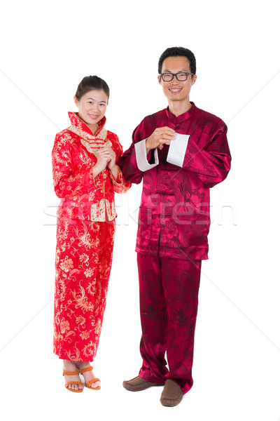 asian couple celebrating chinese new year in traditional clothes Stock photo © yuliang11