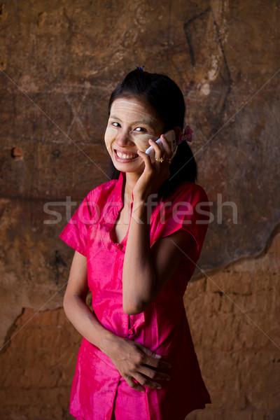 Мьянма девушки мобильного телефона счастливым цветы улыбка Сток-фото © yuliang11