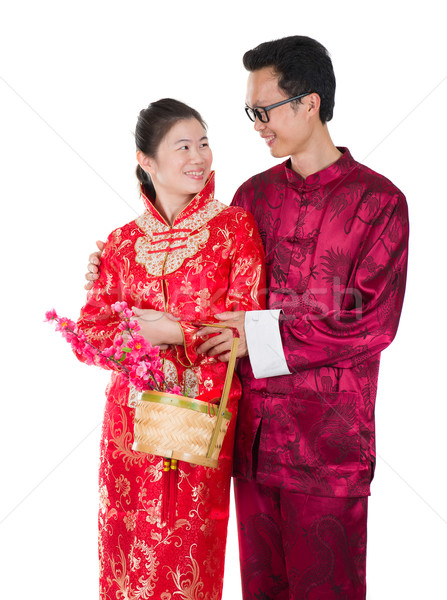 chinese new year couple with basket visiting relatives during fe Stock photo © yuliang11