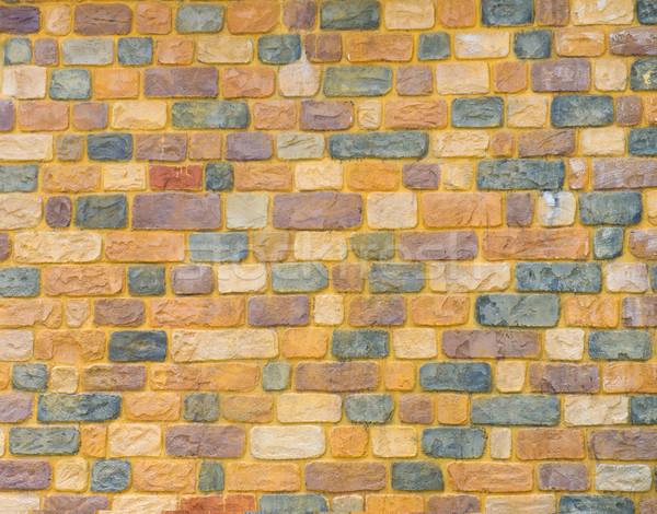 Amarelo parede de tijolos textura propósito pintar urbano Foto stock © yuliang11