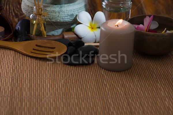tropical spa setup with frangipani flower hot rocks and massage  Stock photo © yuliang11