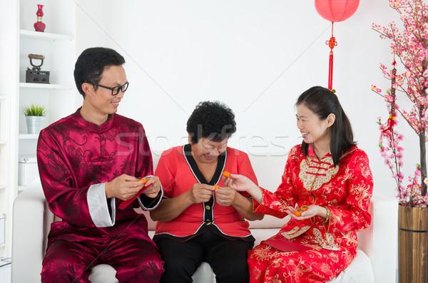 chinese family celebrating lunar new year Stock photo © yuliang11