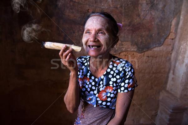 Old Asian woman smoking tobacco. Bagan, Myanmar. Stock photo © yuliang11