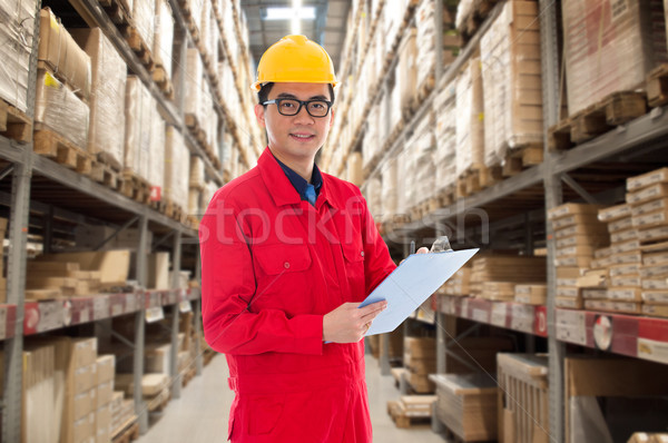 asian chinese male working on a ware house doing stock tick Stock photo © yuliang11