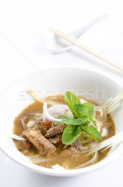 malaysian famous assam laksa isolated in white Stock photo © yuliang11