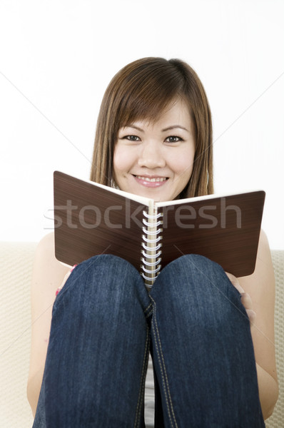Okuma Asya kız oturma kanepe kadın Stok fotoğraf © yuliang11