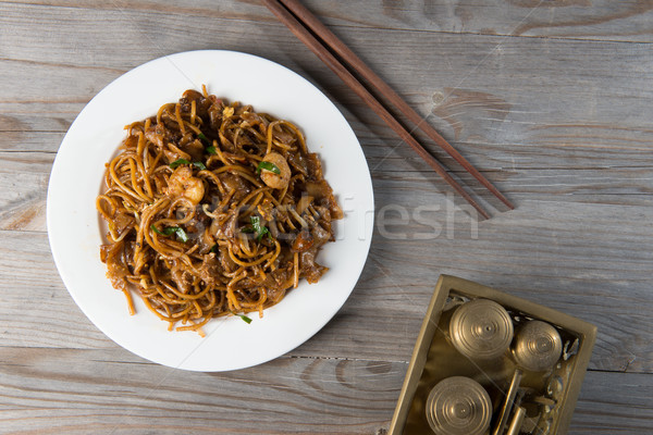 Fried Penang Char Kuey Teow which is a popular noodle dish in Ma Stock photo © yuliang11