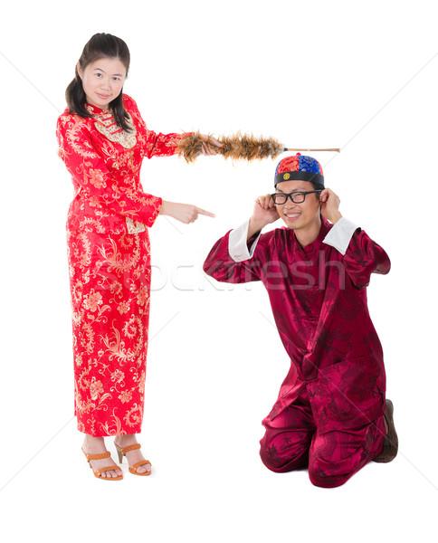 asian bride punishing his groom Stock photo © yuliang11