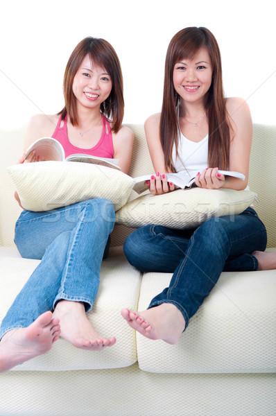 Asya kızlar kanepe ev kadın ev Stok fotoğraf © yuliang11