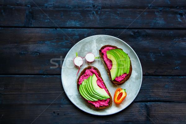 Avocado and beet sandwiches Stock photo © YuliyaGontar