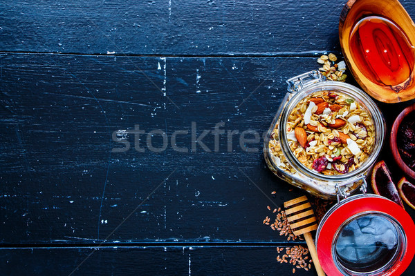 Jar of homemade granola Stock photo © YuliyaGontar