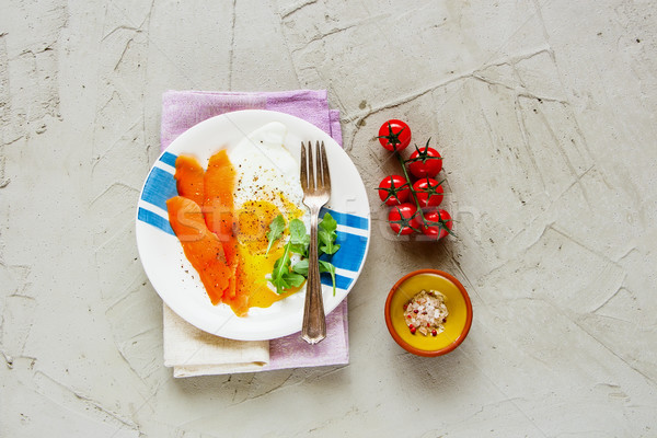 Smoked salmon and fried eggs Stock photo © YuliyaGontar