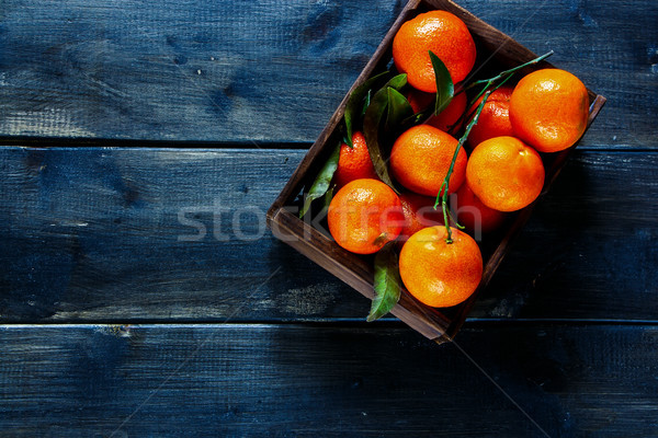 Box of juicy tangerines Stock photo © YuliyaGontar