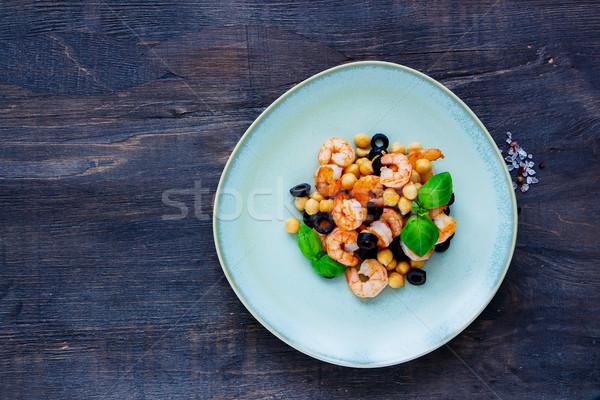 Chickpeas salad in plate Stock photo © YuliyaGontar