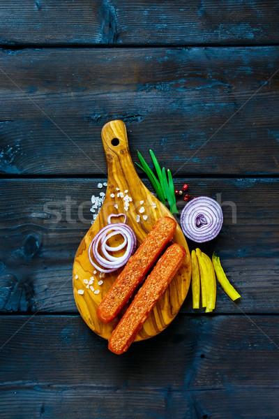 Gustoso alla griglia salsicce cipolla erbe spezie Foto d'archivio © YuliyaGontar