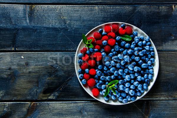 Fresh raspberries and blueberries Stock photo © YuliyaGontar